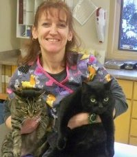 Laurie Box holding two cats
