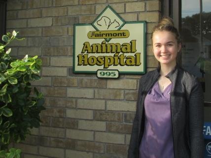 Christine Emeny next to Fairmont Animal Hospital logo